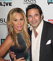 Adrienne Maloof, Paul Nassif.Bravo's Andy Cohen's Book Release Party For &quot;Most Talkative: Stories From The Front Lines Of Pop Held at SUR Lounge, West Hollywood, California, USA..May 14th, 2012.half length black dress suit dress  grey gray.CAP/ADM/KB.&copy;Kevan Brooks/AdMedia/Capital Pictures.
