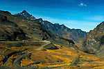 """The jagged peaks of the Andes mountains surround the La Cumbre Pass in Bolivia.  The road starts at an elevation of over 15,000 feet and provides access from La Paz down through """"The World's Most Dangerous Road"""" to the Yungas forests in the north of Bolivia"""