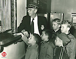 Waterbury<br /> Dec. 4, 1958<br /> <br /> Frist ride on a train and last run on a branch line was the experience of these grammar school boys who bought tickets last night for the final Waterbury-Winsted passenger rail round trip. Conductor James J. McMahon stands at ticket window as the boys get their tickets from the clerk Raymond Martin. The boys are (left to right) David F. Brady, Jr., 5; Michael Brady, 7; David Berdin, 5, (with cap); Charles Wentworth, 11, and William Wentworth, 10.