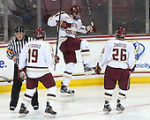 Steven Santini (BC - 6) celebrates after making it 2-1 BC less than a minute after UNH had tied the game at the start of the second period. - The Boston College Eagles defeated the visiting University of New Hampshire Wildcats 6-2 on Friday, December 6, 2013, at Kelley Rink in Conte Forum in Chestnut Hill, Massachusetts.