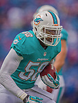14 September 2014: Miami Dolphins linebacker Chris McCain warms up prior to a game against the Buffalo Bills at Ralph Wilson Stadium in Orchard Park, NY. The Bills defeated the Dolphins 29-10 to win their home opener and start the season with a 2-0 record. Mandatory Credit: Ed Wolfstein Photo *** RAW (NEF) Image File Available ***