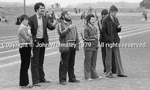Staff with stop watches time the races, Sports Day at the Education Centre, Wester Hailes, Scotland, 1979.  John Walmsley was Photographer in Residence at the Education Centre for three weeks in 1979.  The Education Centre was, at the time, Scotland's largest purpose built community High School open all day every day for all ages from primary to adults.  The town of Wester Hailes, a few miles to the south west of Edinburgh, was built in the early 1970s mostly of blocks of flats and high rises.