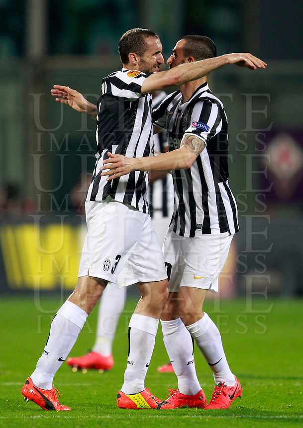 Calcio, ritorno degli ottavi di finale di Europa League: Fiorentina vs Juventus. Firenze, stadio Artemio Franchi, 20 marzo 2014. <br /> Juventus defenders Giorgio Chiellini, left, and Leonardo Bonucci celebrate at the end of the Europa League round of 16 second leg football match between Fiorentina and Juventus at Florence's Artemio Franchi stadium, 20 March 2014. Juventus won 1-0 to advance to the quarter-finals.<br /> UPDATE IMAGES PRESS/Isabella Bonotto
