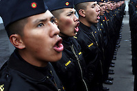 Bolivian Navy students sing at the navy school in La Paz during the raising of the Bolivian flag. Bolivia lost what is now northern Chile in a war over nitrates leaving Bolivia without access to the ocean.