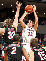 Dec. 22, 2010; Charlottesville, VA, USA; Virginia Cavaliers guard Joe Harris (12) shoots over Seattle Redhawks forward Gavin Gilmore (33), Seattle Redhawks forward Aaron Broussard (2) and Seattle Redhawks forward Chad Rasmussen (15) during the game at the John Paul Jones Arena. Seattle Redhawks won 59-53. Mandatory Credit: Andrew Shurtleff