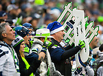 Seattle Seahawks fans cheer on the Seahawks in their game against the Arizona Cardinals d at CenturyLink Field in Seattle, Washington on December 22, 2013.   The Cardinals beat the Seahawks 17-10. ©2013. Jim Bryant Photo. ALL RIGHTS RESERVED.