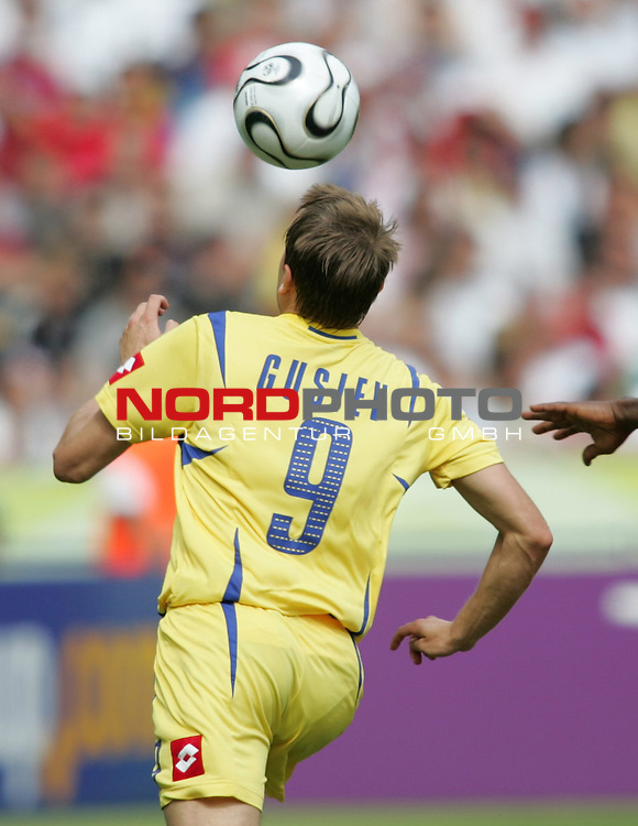 FIFA WM 2006 - Gruppe H ( Group H )<br /> Play #48 (23-Jun) - Ukraine vs Tunisia.<br /> Oleg Gusev from Ukraine faces the ball during the match of the World Cup in Berlin.<br /> Foto &copy; nordphoto