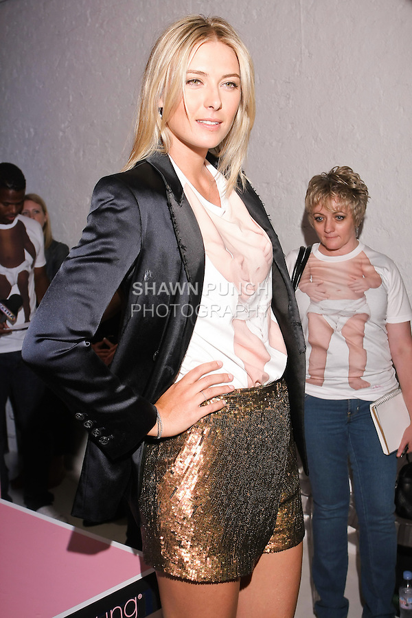 "Maria Sharapova modes a ""Babies On The Inside"" T-shirt at the Evian ""Live Young"" photo shoot event she hosted at Openhouse Gallery on August 24, 2010."