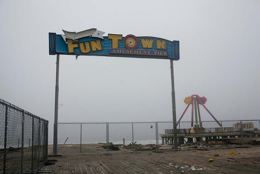 Seaside Heights, NJ - June 30, 2013 : What is left of the Fun Town Pier that was partially destroyed by Superstorm Sandy at Seaside Heights, NJ on June 30, 2013. People are returning to the beaches for the summer after recovery efforts post Superstorm Sandy.