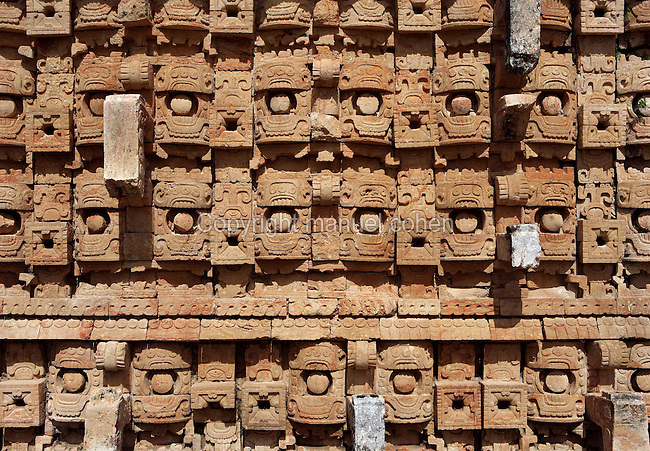 "Western façade of the Codz Poop (""Rolled-up matting"" in Maya), detail of the stone masks of Chaac, the big-nosed god of rain, Puuc Architecture, 700-900 AD, Kabah, Yucatan, Mexico. Picture by Manuel Cohen"