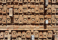 """Western façade of the Codz Poop (""""Rolled-up matting"""" in Maya), detail of the stone masks of Chaac, the big-nosed god of rain, Puuc Architecture, 700-900 AD, Kabah, Yucatan, Mexico. Picture by Manuel Cohen"""