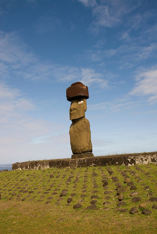 Chile, Easter Island: Statue or moai on a platform or ahu called Ahu Tahai, near the town of Hanga Roa.  This statue is unique because it is the only one that is fully restored, with topknot and eyes. .Photo #: ch214-33112.Photo copyright Lee Foster www.fostertravel.com lee@fostertravel.com 510-549-2202