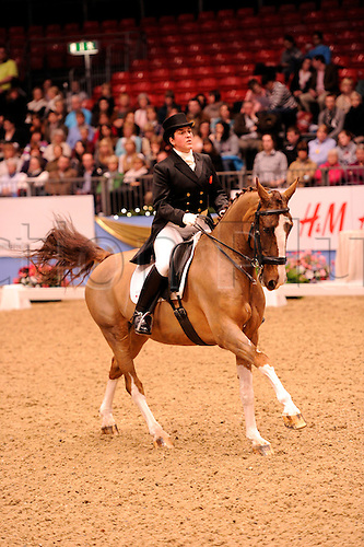 14.12.10 The London International Horse Show Grand Hall Olympia London, UK, Class D1 REEM ACRA FEI WORLD CUP Dressage Grand Prix,Stephanie Croxford of GBR Mr President