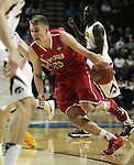 Davidson's Peyton Aldridge (23) drives to the basket against Iowa during 2015 NCAA Division I Men's Basketball Championship March 20, 2015 at the Key Arena in Seattle, Washington.  Iowa beat Davidson 83-52.   ©2015. Jim Bryant Photo. ALL RIGHTS RESERVED.