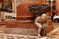 Detail of sculpture of hunchback by Gabriele Caliari, 15th century, beneath font, Basilica of Saint Anastasia, c.1290-1400, by the Dominican friars Fra' Benvenuto da Imola and Fra' Nicola da Imola, Verona, Italy. The so called thin Hunchback sculptures may represent workers at the nearby water mills on the Adige River. Picture by Manuel Cohen.