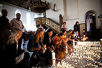 Oslo, Norway, 23.07.2011. People mourn the dead in Domkirken, the main cathedral in Oslo. Oslo awakes to shocking messages of the total bodycount after yesterdays massacre. A total of 91 persons were killed in the massacre in Utøya right outside Oslo. Seven of those died when a car bomb was detonated outside the main government biuilding in the heart of Oslo, friday 22. of July. Foto: Christopher Olssøn.