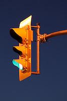 Traffic Signal Against Clear Dusk Sky - Green
