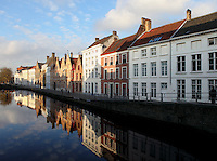 BRUGES, BELGIUM - FEBRUARY 06 : A general view of a canal at sunset on February 06, 2009 in Bruges, West Flanders, Belgium. The bright colors of the residential houses along the canal are reflected in the cool water. (Photo by Manuel Cohen)