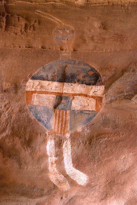 A very unique pictograph on Upper Salt Creek of Canyonlands National Park, Utah, the All American Man Pictograph, has a circular torso painted in red, white and blue stripes. The figure is in an Puebloan habitation alcove. Puebloan style handprint pictographs are also present. The color resemblance to the American flag and modern claims of embellishment led archaeologists to question its prehistoric authenticity.
