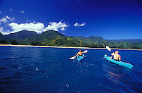 Couple kayaking with Spinner Dolphins at Hanalei Bay, North Shore of Kauai, Hawaii