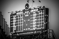 Wrigley Field scoreboard sign in black and white. Wrigley Field is home to the Chicago Cubs baseball team and is one of the oldest ballparks in the United States.