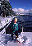 Boy clearing dock of snow at Homewood