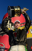Nov. 11, 2012; Pomona, CA, USA: NHRA funny car driver Jack Beckman celebrates after clinching the 2012 championship during the Auto Club Finals at at Auto Club Raceway at Pomona. Mandatory Credit: Mark J. Rebilas-