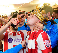 Lincoln City's Jonny Margetts pours beer into the mouth of Lincoln City's Terry Hawkridge, who scored both goals to secure the Imps the Vanarama National League title<br /> <br /> Photographer Chris Vaughan/CameraSport<br /> <br /> Vanarama National League - Lincoln City v Macclesfield Town - Saturday 22nd April 2017 - Sincil Bank - Lincoln<br /> <br /> World Copyright &copy; 2017 CameraSport. All rights reserved. 43 Linden Ave. Countesthorpe. Leicester. England. LE8 5PG - Tel: +44 (0) 116 277 4147 - admin@camerasport.com - www.camerasport.com