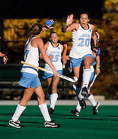 Caitlin Van Sickle (20) of UNC celebrates a goal with teammate Elizabeth Stephens (17) during the NCAA Field Hockey Championship semfinals in College Park, MD.  North Carolina defeated Virginia, 4-3, in overtime.