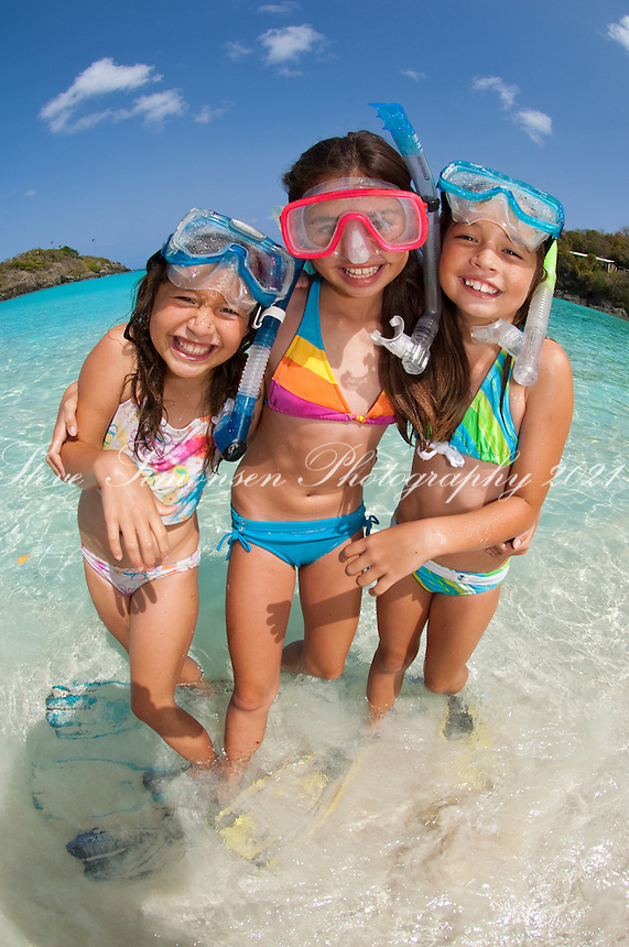 Kids with snorkel gear at the beach Trunk Bay, St. John U.S. Virgin