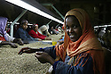 Ethiopian women work on a  production line removing poor quality beans at the Keffa Export Coffee Processing Plant February 21, 2007 in  Addis Ababa, Ethiopia.  The women work 8 hour shifts,  5 days a week, to earn 5 Ethiopian birr per day (62.5 cents.)