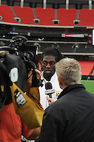 Manchester City striker Emmanuel Adebayor speaks with the assembled media. The press conference for the 2010 Atlanta International Soccer Challenge was held, Tuesday, July 27, at the Georgia Dome, a day in advance of the match between Club America and Manchester City.