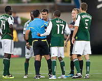 Chris Wondolowski of Earthquakes argues with the referee Hilario Grajeda about a bad call during the game against the TImbers at Buck Shaw Stadium in Santa Clara, California on August 6th, 2011.   San Jose Earthquakes and Portland Timbers tied 1-1.