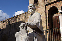 Abú al-Walìd ibn Ruchd, known as Averröes (Cordoba 1126 ? Marrakech 1198), author of scholarly treatises on medicine, mathematics, astronomy, ethics and above all philosophy which had a deep influence on Christian Europe of the 12d century. Sculpture on pedestal beside the Almodovar Gate on the walls of the city, Cordoba, Andalusia, Spain. Picture by Manuel Cohen