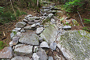 July 2012 - Less than two months after being built, this length of staircase along the Mt Tecumseh Trail in the New Hampshire White Mountains was falling apart. In August 2012, the stones were re-positioned and removed from the footbed of the staircase.