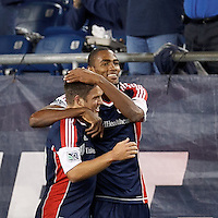 New England Revolution forward Jerry Bengtson (27) celebrates his goal with teammates. In a Major League Soccer (MLS) match, the New England Revolution tied Chivas USA, 3-3, at Gillette Stadium on August 29, 2012.