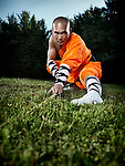 Portrait of a Shaolin warrior monk parcticing staff outdoors