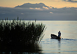 A man heads out to fish at dawn in Karonga, a town in northern Malawi. Fish from Lake Malawi, which is bordered by Malawi, Tanzania and Mozambique, provide an important part of people's diet in this area. Tanzania is in the background