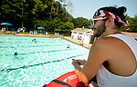 SOUTHBURY, CT--- -070515JS02-- Ryan Cromin of Southbury a lifeguard at the pool for three seasons, keeps an eye on swimmers Sunday at the Southbury town swimming pool at Ballatine Park in Southbury. <br /> Jim Shannon Republican-American