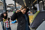 An Afghan mother of two prepares to leave with her family. They have traveled a month and want to settle in Sweden. <br /> <br /> Hundreds of refugees from mostly Syria and Afghanistan gather at the Budapest Keleti railway station waiting for trains to leave for destinations such as Austria, Germany and Sweden, in Budapest, Hungary, on Tuesday, Sept. 8, 2015. Hungary's Prime Minister Viktor Orban created an anti-refugee campaign to generate hate against those fleeing war in their home countries. The country is currently 50% xenophobic and the government has become increasingly authoritarian.