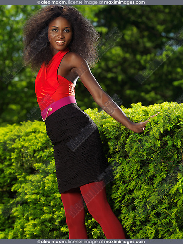 Stock photo: Smiling young stylish black woman in colorful clothes in