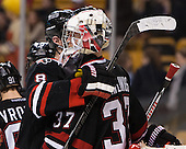 Adam Reid (NU - 8), Chris Rawlings (NU - 37) - The Boston College Eagles defeated the Northeastern University Huskies 6-3 on Monday, February 11, 2013, at TD Garden in Boston, Massachusetts.