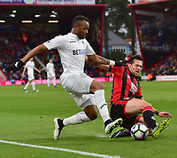 Swansea City's Jordan Ayew (L)battles with Bournemouth's Charlie Daniels (R)<br /> <br /> Bournemouth 2 - 0 Swansea<br /> <br /> Photographer David Horton/CameraSport<br /> <br /> The Premier League - Bournemouth v Swansea City - Saturday 18th March 2017 - Vitality Stadium - Bournemouth<br /> <br /> World Copyright &copy; 2017 CameraSport. All rights reserved. 43 Linden Ave. Countesthorpe. Leicester. England. LE8 5PG - Tel: +44 (0) 116 277 4147 - admin@camerasport.com - www.camerasport.com