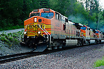 Burlington Northern Santa Fe train engines pulling rail cars through Idaho