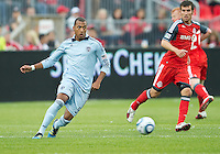 Sporting KC forward Teal Bunbury #9 in action during an MLS game between Sporting Kansas City and the Toronto FC at BMO Field in Toronto on June 4, 2011..The game ended in a 0-0 draw...