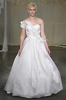 Model walks runway in a Magnolia wedding dress by Carol Hannah Whitfield, for the Carol Hannah Spring Summer 2012 Bridal collection runway show.