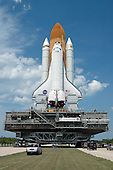 Kennedy Space Center, FL - May 19, 2006 -- Space Shuttle Discovery rolls toward Launch Pad 39B. The shuttle rests on the mobile launcher platform, which is being carried by the crawler-transporter underneath. First motion of the shuttle leaving NASA's Vehicle Assembly Building was at 12:45 p.m. EDT. The rollout is an important step before launch of Discovery on mission STS-121 to the International Space Station. First motion of the shuttle leaving NASA's Vehicle Assembly Building was at 12:45 p.m. EDT. Discovery's launch is targeted for July 1 in a launch window that extends to July 19. During the 12-day mission, Discovery's crew will test new hardware and techniques to improve shuttle safety, as well as deliver supplies and make repairs to the station. .Credit: Dimitri Gerondidakis - NASA via CNP
