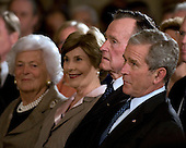 Washington, DC - January 7, 2009 -- United States President George W. Bush, right, former United States President George H.W. Bush, second right, first lady Laura Bush, second left, and former first lady Barbara Bush listen to remarks at Reception in Honor of the Points of Light Institute in the East Room of the White House in Washington, D.C. on Wednesday, January 7, 2009..Credit: Ron Sachs / CNP