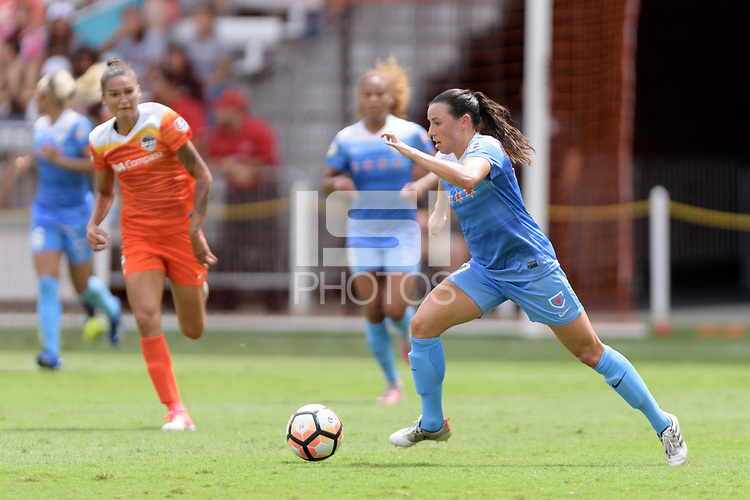Houston, TX - Saturday April 15, 2017: Vanessa DiBernardo brings the ball up the field during a regular season National Women's Soccer League (NWSL) match between the Houston Dash and the Chicago Red Stars at BBVA Compass Stadium.