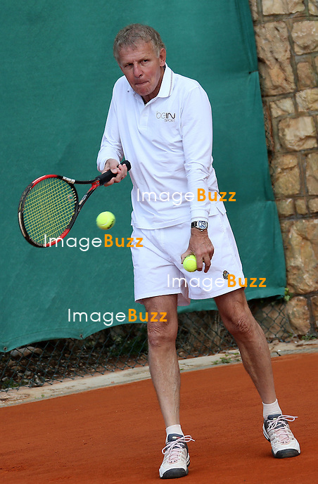 April 21, 2013-H. S. H. Prince Albert II of Monaco playing tennis with Guy Forget, Arnaud Boetsch and Patrick Poivre d'Arvor before the final match at the Monte-Carlo Rolex Masters.